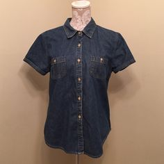 Denim shirt sleeve button up A classic wardrobe staple that can be dressed up or down. In great used condition. Bass Tops Button Down Shirts