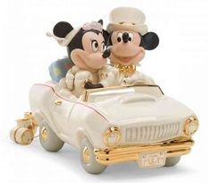 Image from http://images.weddingcollectibles.com/P.cache.x1/Disney-Lenox-Classics-Minnies-Dream-Honeymoon-Wedding-Cake-Topper-Figurine--@2x.jpg.
