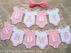 10 DIY Onesies That Say BABY SHOWER with 3 meters of Ribbon. These come to you Un-Assembled, laser cut letters and accessories will need to be glued to the Onesies. Wonderful additions to Baby Showers. Deco Baby Shower, Shower Bebe, Baby Boy Shower, Baby Shower Gifts, Baby Shower Bunting, Ballerina Baby Showers, Girl Baby Shower Decorations, Baby Shower Themes, Shower Ideas