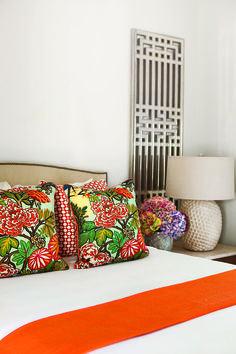 Orange floral pillows in the bedroom
