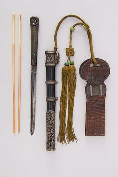 Knife with Sheath, Chopsticks and Belt Loop Date: ca. 1750–1900  Culture: Chinese, Manchuria or Mongolian Medium: Steel, wood, ebony, ivory, silver, brass, leather, coral
