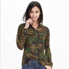 NWOT Banana Republic Camo Chiffon Shirt XS Petite. NWOT -- never worn, brand new. Chiffon material is somewhat sheer. Edgy Camo pattern in dark army greens and Browns. I included a sizing chart from banana republic Banana Republic Tops Button Down Shirts