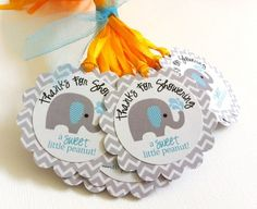 Little Peanut Baby Boy Elephant Favor Tags in Gray, Blue and Chevron @adorebynat  These elephant favor tags are so cute and perfect for a baby boy shower party! The gray elephant with blue stripe ear playing with water is so cute. Each gift tag has a fun phrase that says Thanks for Showering a Sweet Little Peanut! I use Chevron pattern in gray as the background which certainly makes this tag adorable.