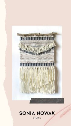 This textured woven wall hanging is centered on a wooden dowel and finished with a cord for hanging. Woven in beige and blue colours using only natural fibers. The hand woven tapestry provides a contemporary boho-inspired charm to any space.
