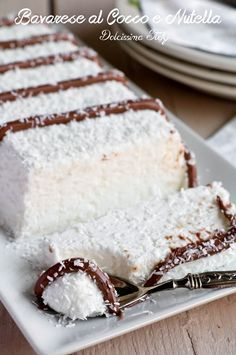 INGREDIENTS for a long plumcake tin of whipping cream of icing sugar of coconut flour of gelatine sheets of hazelnut grain A few tablespoons of Nutella Italian Desserts, Sweet Desserts, Sweet Recipes, Delicious Desserts, Cake Recipes, Dessert Recipes, Yummy Food, Nutella, Kolaci I Torte