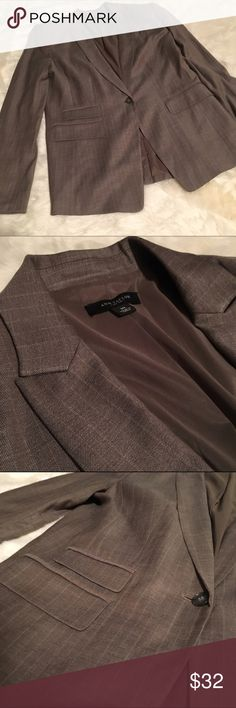 Ann Taylor Wool Suit Jacket Nice wool fitted suit jacket by Ann Taylor in great condition. Brown in color. Fabric is 55% Virgin Wool, 43% Rayon and 2% Lycra Soandex. Fully lined in polyester and spandex blend. Dry clean only. One button closure. Let me know if you have any questions. Offers welcome and bundles encouraged. Ann Taylor Jackets & Coats Blazers