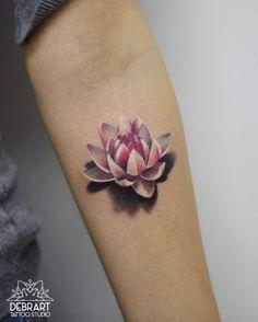 Pink lotus flower on forearm by Deborah Genchi #lotusflowertattoos