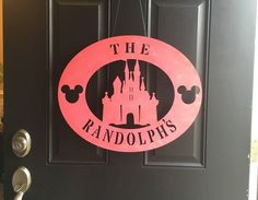 This Wooden Disney Door Sign is Perfect for Year Round Decor