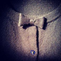 Cashmere bow and swarovski button.