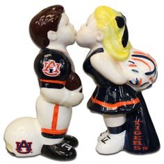 """Spice up your dining room or even top a wedding cake with these adorable ceramic salt and pepper shakers made by Jenkins Enterprises! Each shaker stands 4"""" tall and are hand painted for Gameday Outfitters"""