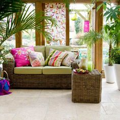 pops of color and rattan furniture ensure a fun and comfortable tropical seating area