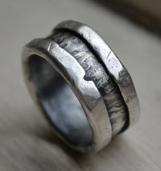 Completely handcrafted / fabricated through solid metalwork, in Asheville, NC. No mass production is involved. Great attention to detail, love and care is put into each handcrafted ring, making it one-of-a-kind. We love that we are crafting something very special and meaningful for you. All designs are built to last.  Width pictured: 11mm (choose between 8-11mm wide at purchase) Thickness: 2.5mm approximately, 1.8mm thick can be requested Materials: .999 Fine silver and .925 Sterling Silver…