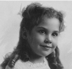 Pretty little missy with curly hair and chocolate eyes. Antique Victorian era cabinet card photo of a darling little girl.
