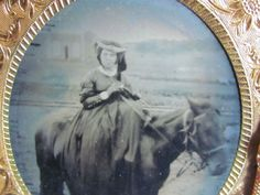 woman with long flowing dress sitting on a horse tintype photo & case