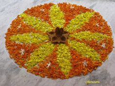 A simple Rangoli for Diwali made with real flower petals, , change to tissue paper and make on a paper plate or pie plate Rangoli Side Designs, Small Rangoli Design, Rangoli Patterns, Colorful Rangoli Designs, Rangoli Designs Diwali, Diwali Rangoli, Ganpati Decoration At Home, Diwali Decorations At Home, Festival Decorations