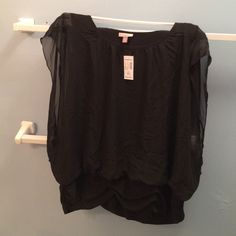 Dressbarn sleeveless banded bottom Roz & Ali top NWT Roz & Ali top. Sheer overlay attached to black top underneath. Roz & Ali Tops Blouses