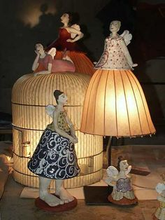 Raelyn Larson, an American living in France, creates delightfully whimsical lamps that are fairylike figures with lampshade skirts of light!