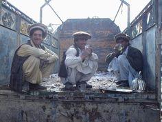 Shkin, Paktia Province Afghanistan  Pashtun men on the back of a truck drinking tea.