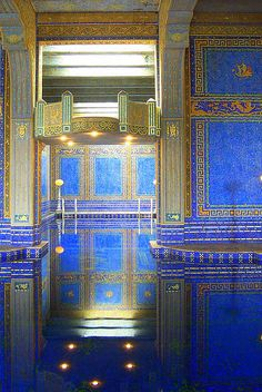 GOLDEN POOL   The indoor swimming pool at Hearst Castle in California. Every last inch of the walls are covered in tiny tiles and gold leaf- you can just glimpse the starburst pattern in the tile on the floor of the pool near the reflection of the lights at the bottom of the image.