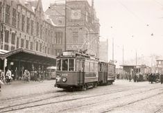 1955. A view of the Stationsplein with tram line 2 in Amsterdam. On the left the Centraal Station. Photo L. Alberts. #amsterdam #1955 #Stationsplein #CentraalStation