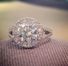 Dream ring!  Round halo engagement ring with split shank