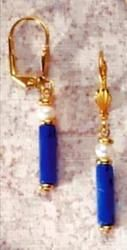 """Lapis Tube & Pearl Earrings - Lapis lazuli, the """"sapphire"""" of the ancients, was favored for its deep, blue color often flecked with """"gold"""" (iron pyrite). The Egyptians regarded lapis as a sacred stone of celestial origin and a symbol for truth. Regalia made of gold and lapis was believed to place the wearer under the protection of the sun and heaven. $24"""