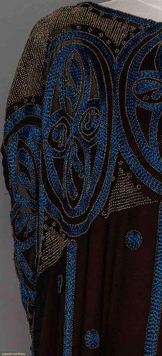 1920s black chiffon tunic w/ blue floss embroidery & dull gold beads, a-symmetrical hem. Detail