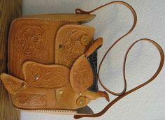My mom gave me a purse that looks identical to this (It might be the same one) and I love it. She's had it since she was a teenager, it's made to look like a horse saddle and perfect considering my love for all things southern/western and horses!