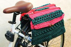 Crochet saddlebags for bicycle, convertible in shoulder bag. Bike panniers. It measures 15,2 (39 cm) wide by 13 (33 cm) high. Adapts to different sizes using a long adjustable handle, that hook up to the sides with two snap hooks, which also serves to easily fasten the saddlebag to the bicycle. It is a completely handmade and unique saddlebag.