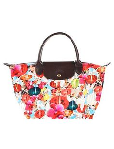 Mary Katrantzou for Longchamp Bags.  I got this in Spain