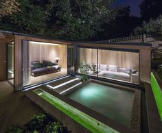 A beautiful, elegant and modern garden studio with a hot tub, floating steps and innovative lighting. CED's Yorkstone was utilised perfectly in this design.