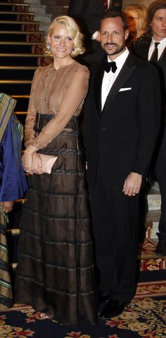 Crown Prince Haakon and Crown princess Mette-Marit, Norway  royals brown beige gown.   They are just a beautiful couple!!!!!