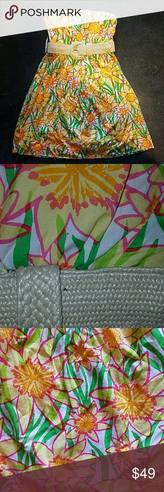 OBO Lilly Wyatt Sunflower Pattern Dress Cute and bright sunflower patterned dress with belt included. Small, brown spot right above belt in pic 2, but not terribly noticeable. Dress is a size 0, the size tab recently came detached and has since been misplaced  (see pic 4). Reasonable Offers are always welcome. :) Lilly Pulitzer Dresses Strapless