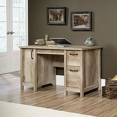 This computer desk has the functionality you need combined with the style you want. Features of this home office desk include:  Three drawers with metal runners and safety stops. Lower drawer holds letter-size hanging files. Storage area behind door features an adjustable shelf and holds vertical CPU tower. Finished on all sides. Lintel Oak finish.