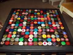 Windfarm: How to make a bottle cap table- Just one more way to do it. I like the idea of filling the bottle caps with hot glue first. Gluing would've been easier with this prep.