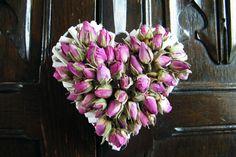Dried flower buds glued onto a heart wreath make a simple rosebud heart http://driedflowercraft.co.uk