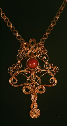 Copper Wire Necklace with Vintage Maroon Glass Bead. $125.00, via Etsy.