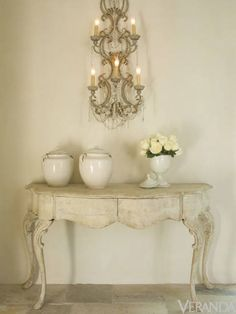 Interior design by MILIEU editor Pamela Pierce inspired by French, Swedish, Belgian, European, Gustavian, Scandinavian antiques, modern art, minimal, feminine, romantic, timeless, tranquil, farmhouse style and elegant traditional decor, reclaimed stone floors, biots, white roses, linen, slipcovers, ruffles, skirted tables, Lefroy Brooks fixtures, cremone bolts, steel windows and doors, rustic wood, white, neutrals, French country, Chateau Domingue, oversize sconces, and chandeliers.