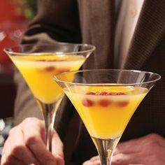 Orange Razzletini *********Ice cubes******* 1/2 cup orange juice******** 2 ounces raspberry-flavored rum******* 1/2 ounce Triple Sec********* Orange slices and fresh raspberries, optional