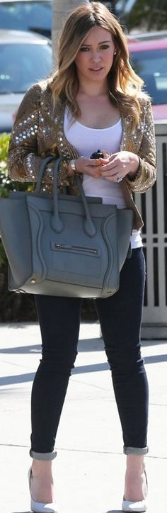 Who made  Hillary Duff's white pumps, gold jacket, blue skinny jeans, and gray handbag?