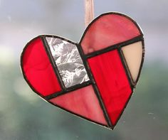 Super cute geometric stained glass heart.