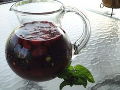 Sittin'  on the Patio Sangria  1 bottle  Cabernet Sauvignon (about 3 1/4 c.)  ½ liter White Zinfandel (about 2 c.)  3 oz. brandy  Juice of one lemon  1 ¼ c. orange juice (Or use any fruit juice you have on hand)  1/2 c. simple syrup   1 peach, sliced  1 apricot, sliced  ½ cup fresh blackberries  ½ cup fresh strawberries, quartered  Mint for garnish  Club soda, optional