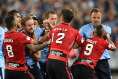 Wanderers and Sydney FC players scrap. As predicted no love lost between local rivals in front of a record attendance of 61,880 at Sydney Olympic Park on Sat. 08.10.16. HAL.1