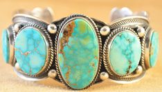 Handmade row cuff bracelet, with natural Turquoise Mountain turquoise, by Navajo artist Andy Cadman.