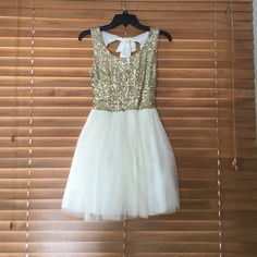 Homecoming/ short dress Gold sequin on top with off white bottom. Bow on back is re-tie able. Zip up back as well. B. Darlin Dresses