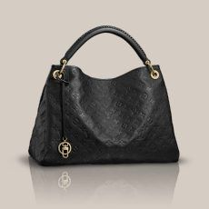 Artsy MM Monogram Empreinte Spacious, sophisticated and chic, the Artsy MM is a timeless tote bag. In sumptuous embossed Monogram Empreinte leather, a luxuriously ornate handle and rich golden brass pieces create a refined look.