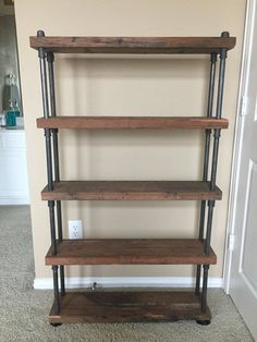 handmade industrial wooden shelf with black steel pipe makes for the perfect modern-rustic chic organizational statement piece in any style home. this entire unit is 32in wide by 54in tall including 5 shelves. each shelf is 7.25in deep and 1.5in thick. assembly required; no tools