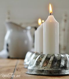 Vintage Tins turned into Candle Holders