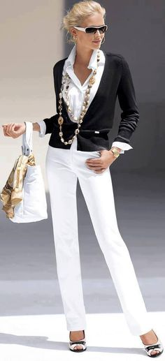 Very chic, the necklace defines the look.