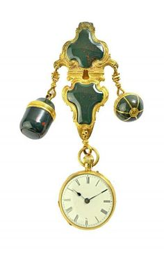 A lady's 18ct gold cased, keyless wind, openfaced fob watch, the enamelled dial with black Roman numerals, the case London 1873, fitted to a gilt metal and bloodstone set chatelaine clip, having two pendant drops, comprising; a spherical box, with a motto to the band, detailed A SMILE FROM THEE IS A WORLD TO ME and a drop shaped box, with a threaded top.